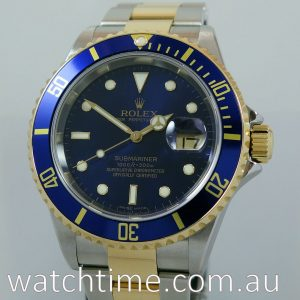 Rolex Submariner Date 18k   Steel   Mint  Blue dial 16613  Box   Papers