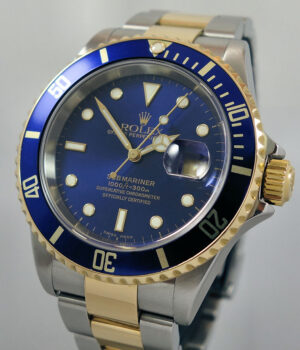 Rolex Submariner Date 18k   Steel  Blue dial 16613 Box   Books  ON HOLD